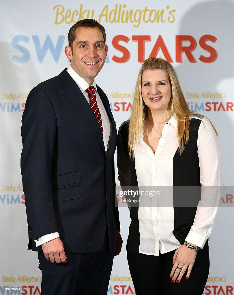 Rebecca Adlington poses with Steve Parry during a press conference as she announces her retirement from swimming, at InterContinental London Westminster Hotel on February 5, 2013 in London, England.