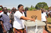 Rebecca AkufoAddo the wife of presidential candidate of the opposition New Patriotic Party Nana AkufoAddo casts her ballot as she votes at the...