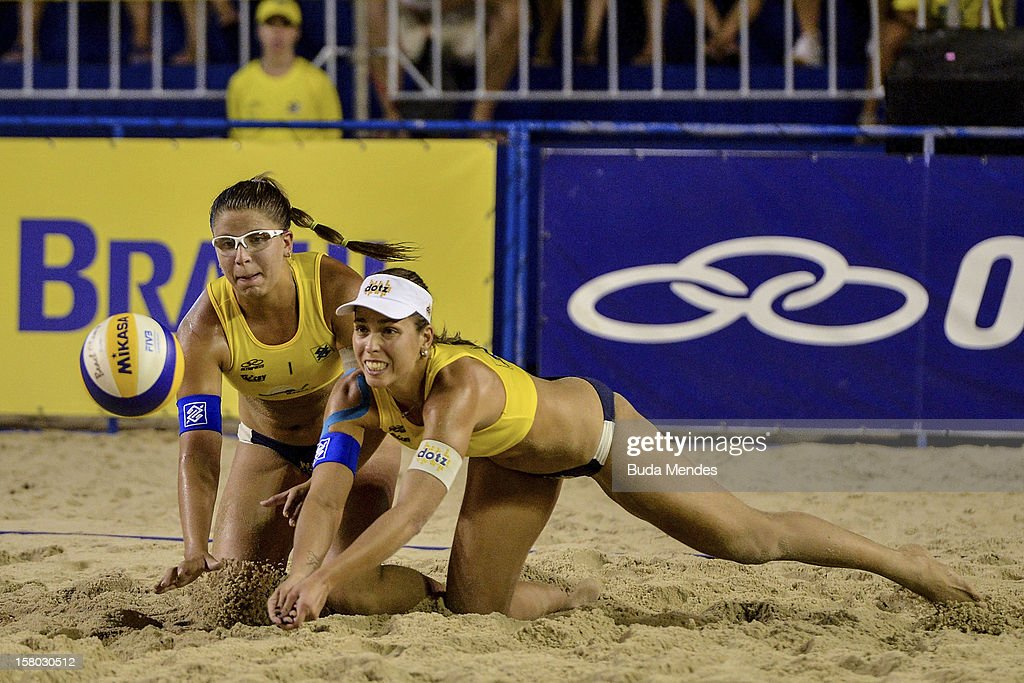 Rebecca (L) and Lili (R) in action during a beach volleyball match as part of the 6th stage of the season 2012/2013 Circuit Bank of Brazil at Copacabana Beach on December 08, 2012 in Rio de Janeiro, Brazil.
