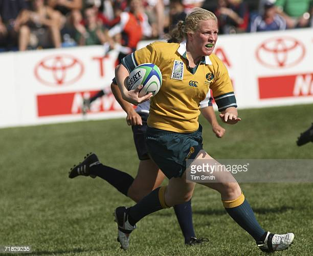 Rebecca Anderson of Australia runs the ball against USA during day three of the Women's Rugby World Cup 2006 at St Albert Rugby Football Club on...