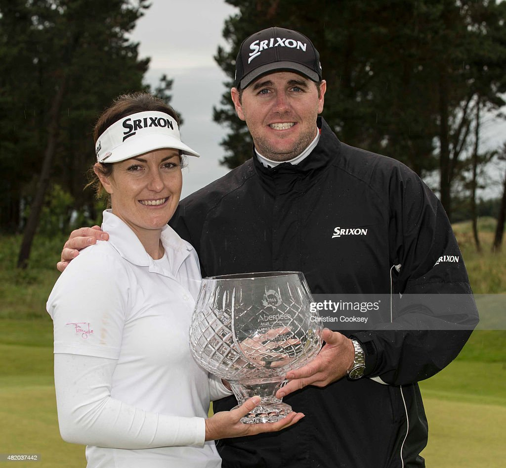 Rebecca Artis of Australia poses with the trophy and husband Geoff who is also her caddy after wining the Aberdeen Asset Management Scottish Ladies Open at Dundonald Links Golf Course on July 26, 2015 in Troon, Scotland.