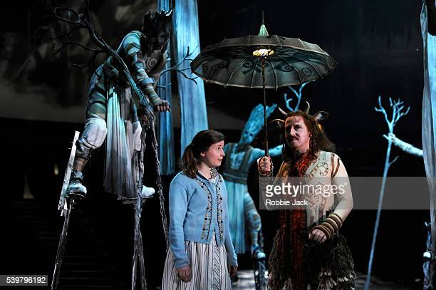 Rebecca Benson as Lucy and Forbes Masson as Mr Tumnus in Rupert Goold's stage adaptation of CS Lewis's The Lion the Witch and the Wardrobe directed...