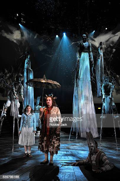 Rebecca Benson as Lucy and Forbes Masson as Mr Tumnus with artists of the company in Rupert Goold's stage adaptation of CS Lewis's The Lion the Witch...