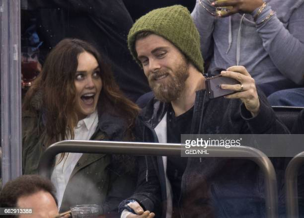 Rebecca Breeds and Luke Mitchell attend Pittsburgh Penguins Vs New York Rangers game at Madison Square Garden on March 31 2017 in New York City