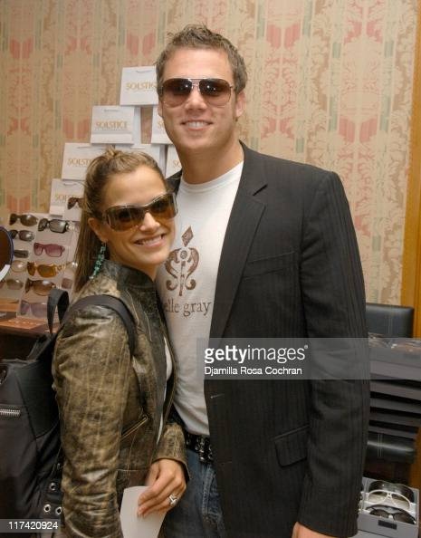 Rebecca Budig wearing Bottega Veneta 01 SML Sunglasses and Bob Guiney wearing Marc Jacobs 16S Sunglasses