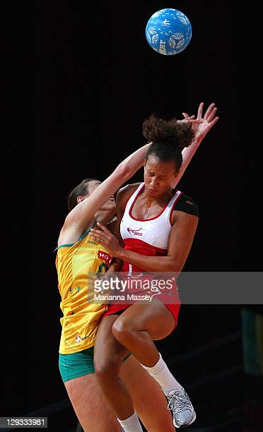 Rebecca Bulley of Australia and Serena Guthrie of England clash during game three of the International Test series between the Australian Diamonds...