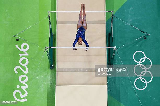 Rebecca Downie of Great Britain competes on the uneven bars during Women's qualification for Artistic Gymnastics on Day 2 of the Rio 2016 Olympic...