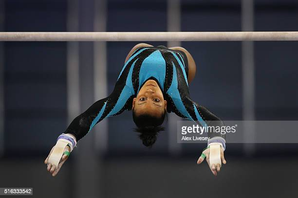 Rebecca Downie of the British Gymnastics Team performs on the Uneven Bars during Women's National Senior Team Championships at the Emirates Arena on...