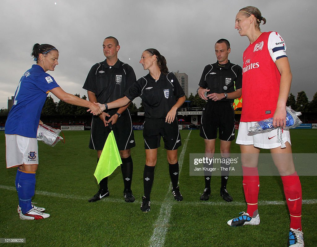 Rebecca Easton of Everton (L) and <a gi-track='captionPersonalityLinkClicked' href=/galleries/search?phrase=Faye+White&family=editorial&specificpeople=171388 ng-click='$event.stopPropagation()'>Faye White</a> of Arsenal toss the coin with Referee <a gi-track='captionPersonalityLinkClicked' href=/galleries/search?phrase=Sian+Massey&family=editorial&specificpeople=6733765 ng-click='$event.stopPropagation()'>Sian Massey</a> prior to the FA Women's Super League match between Arsenal Ladies FC and Everton Ladies FC at Meadow Park on August 18, 2011 in Borehamwood, England.