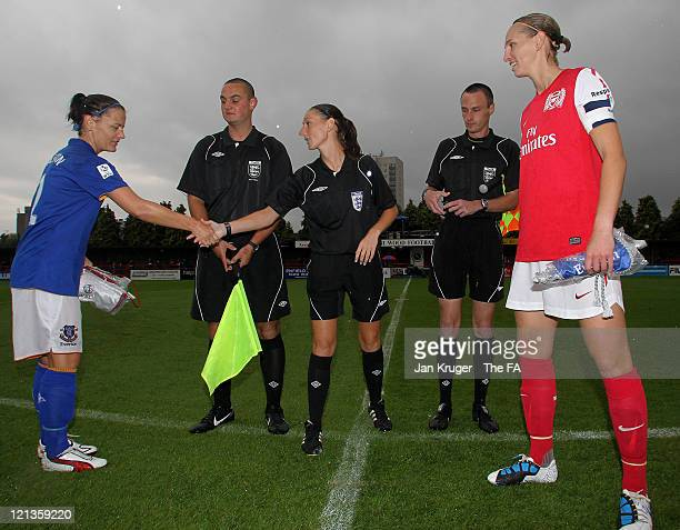 Rebecca Easton of Everton and Faye White of Arsenal toss the coin with Referee Sian Massey prior to the FA Women's Super League match between Arsenal...