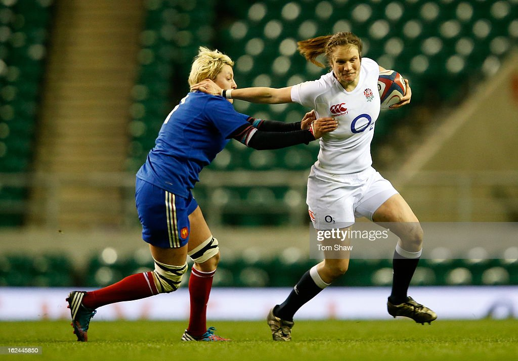 Rebecca Essex of England holds off Laetitia Grand of France during the Women's RBS Six Nations match between England and France at Twickenham Stadium on February 23, 2013 in London, England.