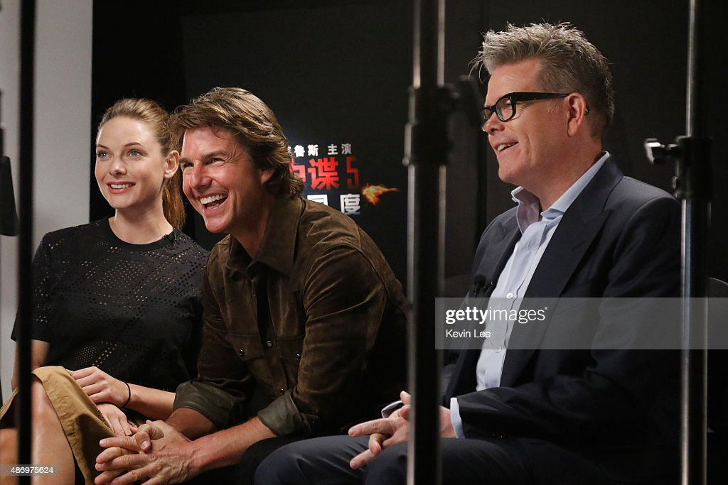 Rebecca Ferguson, Tom Cruise, and Director Christopher McQuarrie, reacts during a tele-broadcasting with fans in a cinema in Chengdu on August 5, 2015 in Shanghai, China.