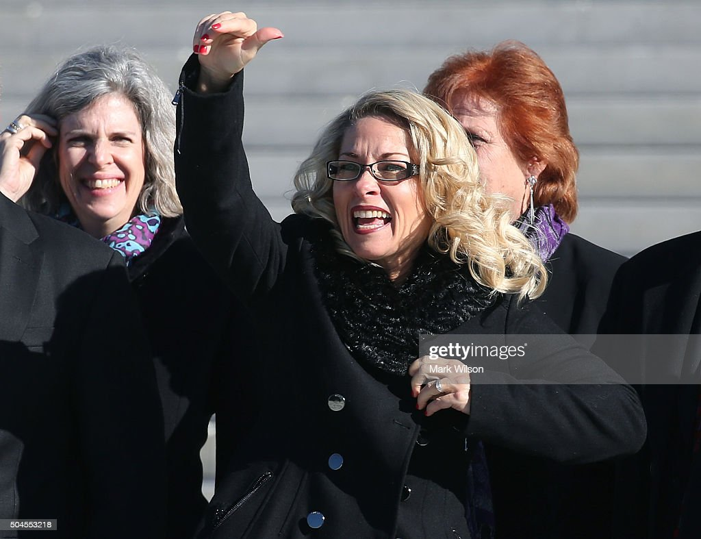 Rebecca Friedrichs waves to supporters after arguments at the US Supreme Court January 11 2016 in Washington DC Today the high court is hearing...