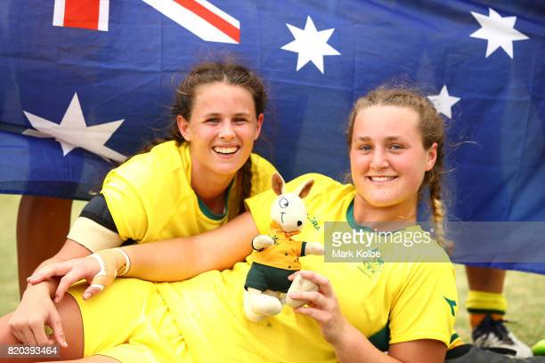 Rebecca Goulding and Arabella McKenzie of Australia celebrate with the team mascot after winning the girl's rugby 7's gold medal final match between...