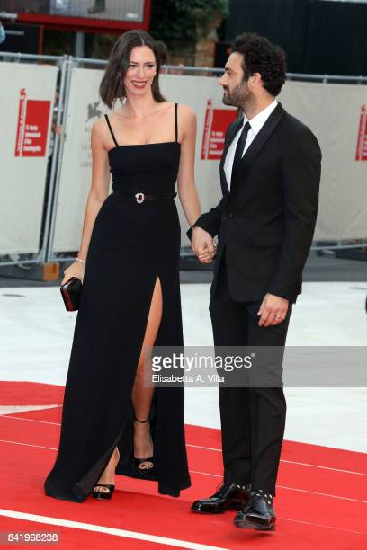 Rebecca Hall and Morgan Spector walk the red carpet ahead of the 'Suburbicon' screening during the 74th Venice Film Festival at Sala Grande on...