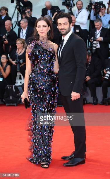 Rebecca Hall and Morgan Spector walks the red carpet ahead of the 'Downsizing' screening and Opening Ceremony during the 74th Venice Film Festival at...