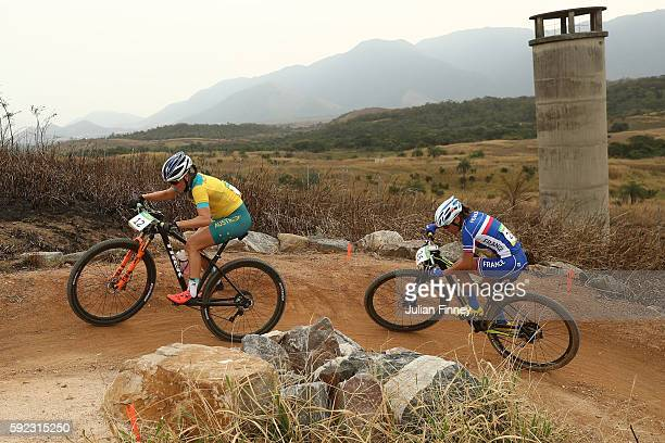 Rebecca Henderson of Australia and Perrine Clauzel of France race during the Women's CrossCountry Mountain Bike Race on Day 15 of the Rio 2016...