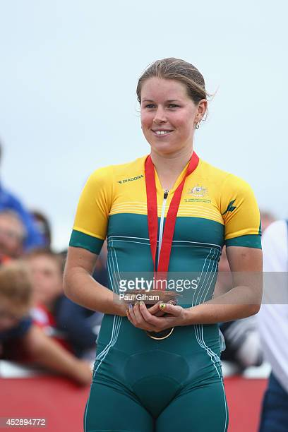 Rebecca Henderson of Australia celebrates winning a bronze medal in the Women's Cross Country Mountain Biking at Cathkin Braes Mountain Bike Trails...