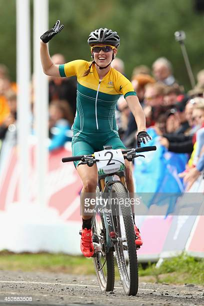 Rebecca Henderson of Australia celebrates winning bronze in the Women's Crosscountry Mountain Biking at Cathkin Braes Mountain Bike Trails during day...