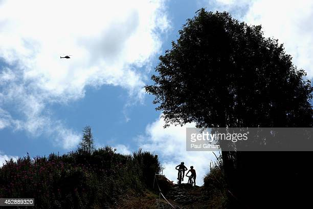 Rebecca Henderson of Australia leads Emily Batty of Canada during the Women's Cross Country Mountain Biking at Cathkin Braes Mountain Bike Trails...