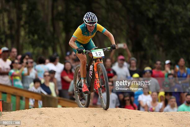 Rebecca Henderson of Australia races during the Women's CrossCountry Mountain Bike Race on Day 15 of the Rio 2016 Olympic Games at the Mountain Bike...