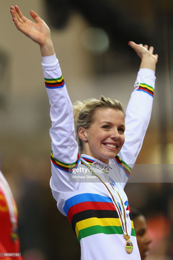 Rebecca James of Great Britain celebrates on the winners podium after winning gold in the women's keirin final on day five of the 2013 UCI Track World Championships at the Minsk Arena on February 24, 2013 in Minsk, Belarus.