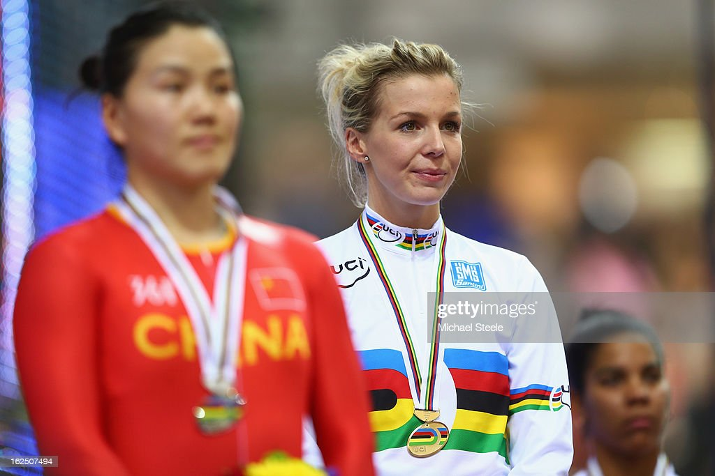 Rebecca James (C) of Great Britain celebrates on the winners podium after winning gold in the women's keirin final alongside silver medalist Jinjie Gong (L) of China and bronze medalist Lisandra Guerra Rodriguez (R) of Cuba on day five of the 2013 UCI Track World Championships at the Minsk Arena on February 24, 2013 in Minsk, Belarus.