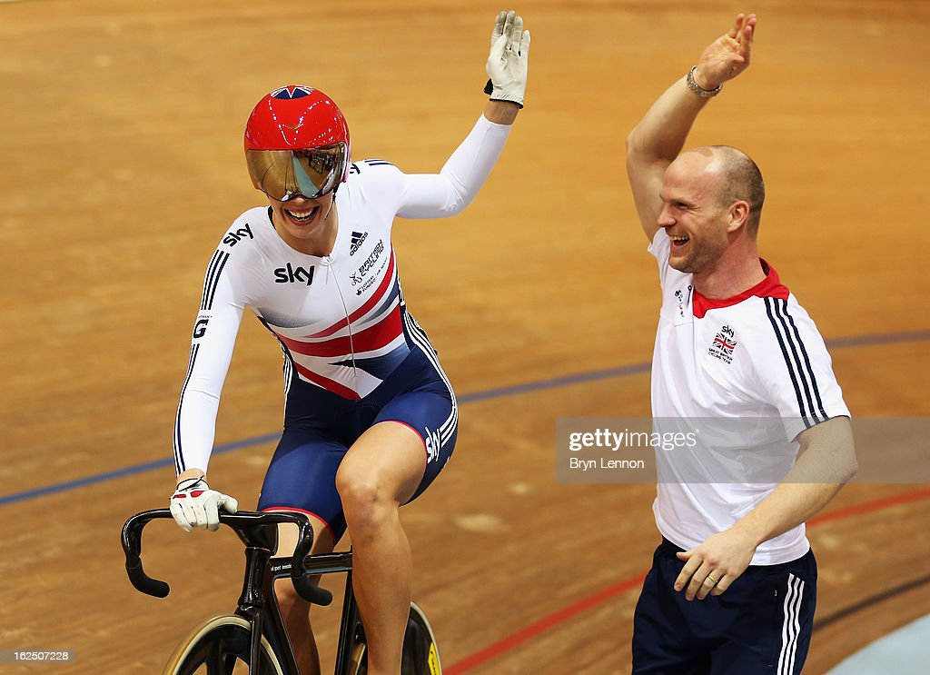 Rebecca James of Great Britain celebrates with Great Britain Sprint Coach Jan Van Eijden after winning the Women's Keirin final on day five of the 2013 UCI Track World Championships at the Minsk Arena on February 24, 2013 in Minsk, Belarus.