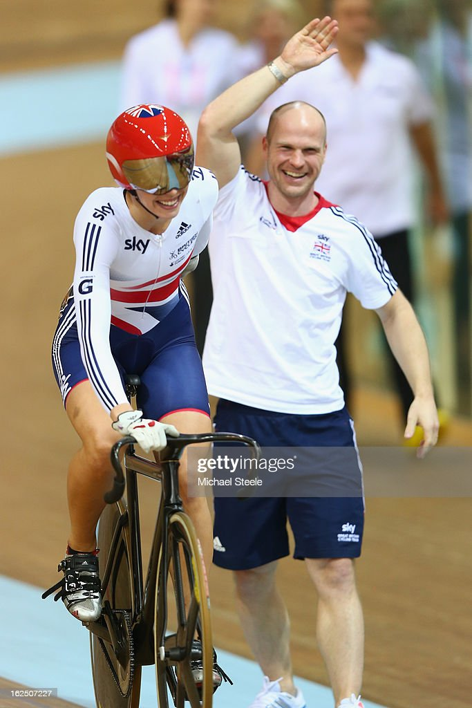 Rebecca James (L) of Great Britain celebrates with sprint coach Jan van Eijden (R) after winning gold in the women's keirin final on day five of the 2013 UCI Track World Championships at the Minsk Arena on February 24, 2013 in Minsk, Belarus.