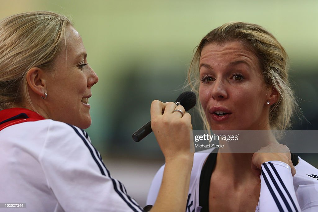 Rebecca James (R) of Great Britain has makeup put on by Hanlie Fouche (L) a team carer before the medal ceremomy after claiming her second gold and four medals in total after victory in the women's keirin final on day five of the 2013 UCI Track World Championships at the Minsk Arena on February 24, 2013 in Minsk, Belarus.