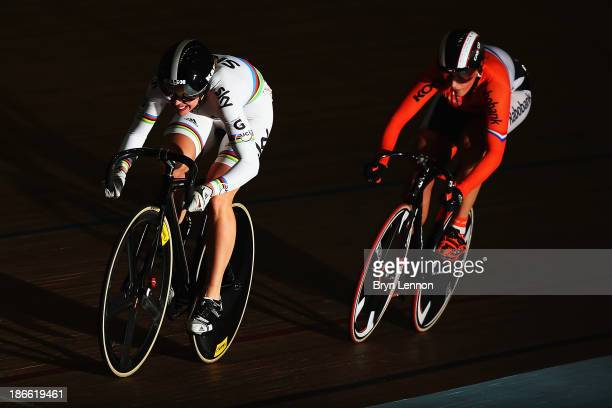 Rebecca James of Great Britain rides against Elis Lightee of The Netherlands in race one of the Women's Sprint Quarter Finals on day two of the UCI...