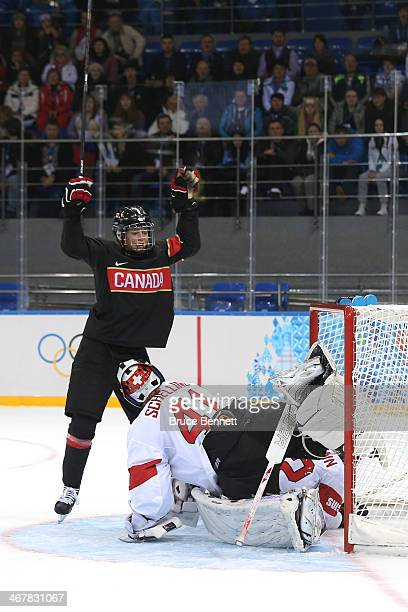 Rebecca Johnston of Canada celebrates after scoring a goal against Florence Schelling and Sandra Thalmann of Switzerland in the second period during...