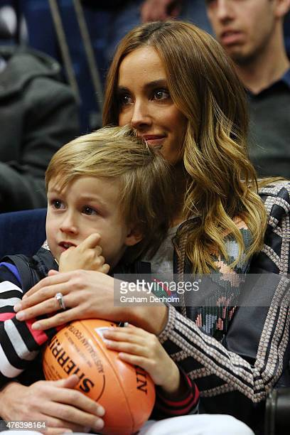 Rebecca Judd and son Oscar Judd look on during a Carlton Blues AFL press conference announcing Chris Judd's retirement at Ikon Park on June 9 2015 in...