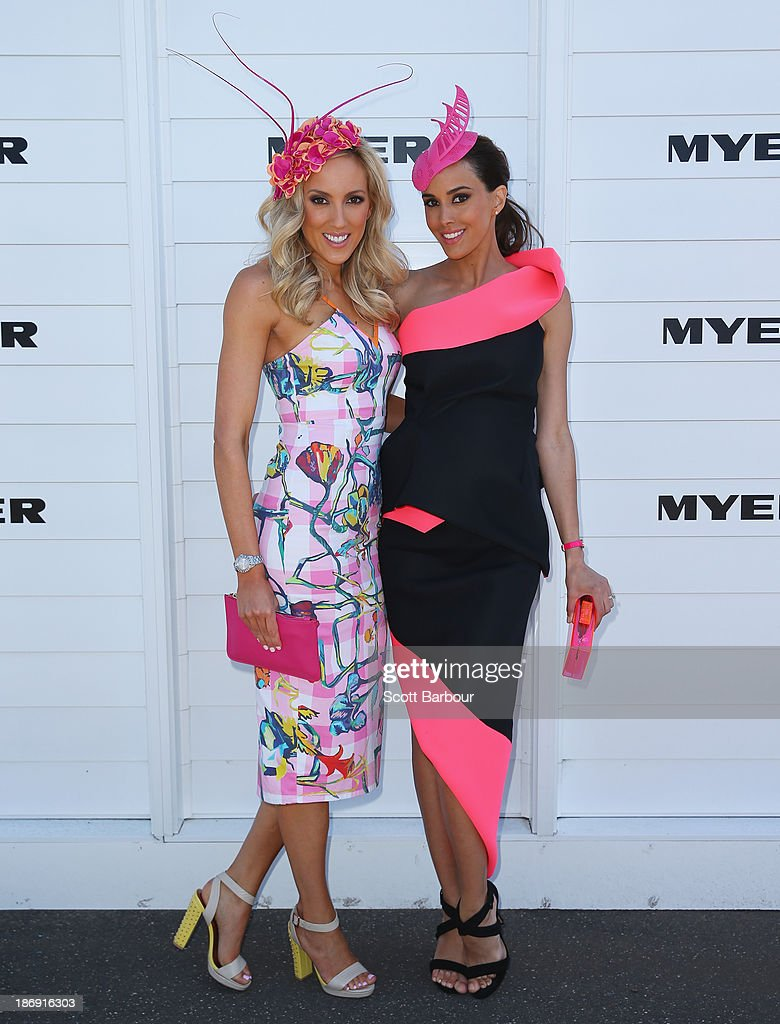 Rebecca Judd (R) poses with her sister Kate Twigley as they attend the Myer marquee during Melbourne Cup Day at Flemington Racecourse on November 5, 2013 in Melbourne, Australia.