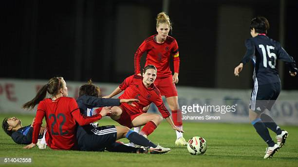 Rebecca Knaak and Rieke Dieckmann of Germany and Mayu Sasaki of Japan fight for the ball during the women's U23 international friendly match between...