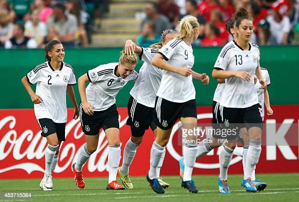 Rebecca Knaak of Germany reacts after scoring a goal against Canada during the FIFA U20 Women's World Cup Canada 2014 Quarter Final match between...