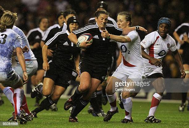 Rebecca Mahoney of New Zealand is tackled by Katy McLean of England during the Women's International match between England and New Zealand at...