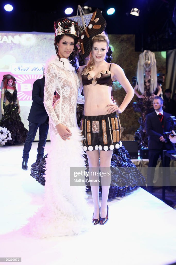 Rebecca Mir and Amelie Klever wearing creations out of Cake packagins by artist Larisa Katz Art couture attend the Lambertz Monday Night at Alter Wartesaal on January 28, 2013 in Cologne, Germany.