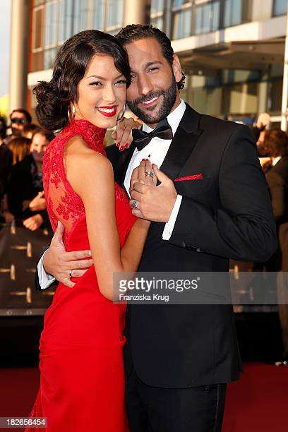 Rebecca Mir and Massimo Sinato attend the Deutscher Fernsehpreis 2013 Red Carpet Arrivals at Coloneum on October 02 2013 in Cologne Germany