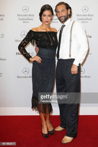 Rebecca Mir and Massimo Sinato attend the Laurel show during the MercedesBenz Fashion Week Spring/Summer 2015 at Erika Hess Eisstadion on July 10...