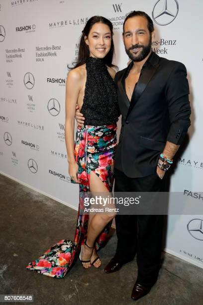 Rebecca Mir and Massimo Sinato attend the Lena Hoschek show during the MercedesBenz Fashion Week Berlin Spring/Summer 2018 at Kaufhaus Jandorf on...