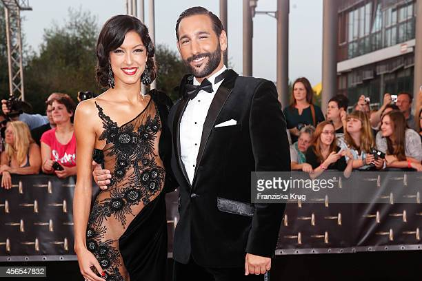 Rebecca Mir and Massimo Sinato attend the red carpet of the Deutscher Fernsehpreis 2014 on October 02 2014 in Cologne Germany