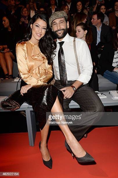 Rebecca Mir and Massimo Sinato attend the 'Shop the Runway by FASHION ID' show during the MercedesBenz Fashion Week Berlin Autumn/Winter 2015/16 at...