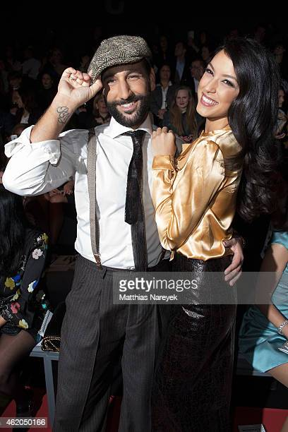 Rebecca Mir and Massimo Sinato attend the Shop the Runway show during the MercedesBenz Fashion Week Berlin Autumn/Winter 2015/16 at Brandenburg Gate...