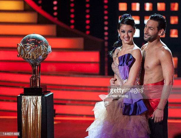 Rebecca Mir and Massimo Sinato standing beside the trophy during 'Let's Dance' Semi Finals at Coloneum on May 16 2012 in Cologne Germany