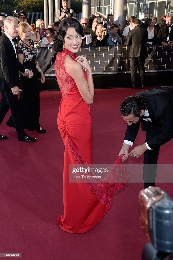 <a gi-track='captionPersonalityLinkClicked' href=/galleries/search?phrase=Rebecca+Mir&family=editorial&specificpeople=7831846 ng-click='$event.stopPropagation()'>Rebecca Mir</a> attends the Deutscher Fernsehpreis 2013 at the Coloneum on October 2, 2013 in Cologne, Germany.