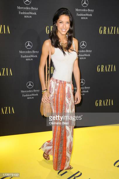 Rebecca Mir attends the MercedesBenz Fashion Week Berlin Spring/Summer 2014 Preview Show by Grazia at the Brandenburg Gate on July 1 2013 in Berlin...