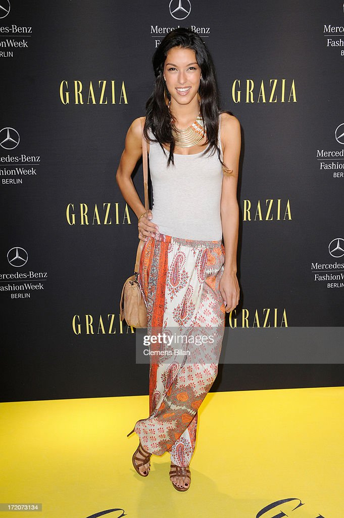 <a gi-track='captionPersonalityLinkClicked' href=/galleries/search?phrase=Rebecca+Mir&family=editorial&specificpeople=7831846 ng-click='$event.stopPropagation()'>Rebecca Mir</a> attends the Mercedes-Benz Fashion Week Berlin Spring/Summer 2014 Preview Show by Grazia at the Brandenburg Gate on July 1, 2013 in Berlin, Germany.