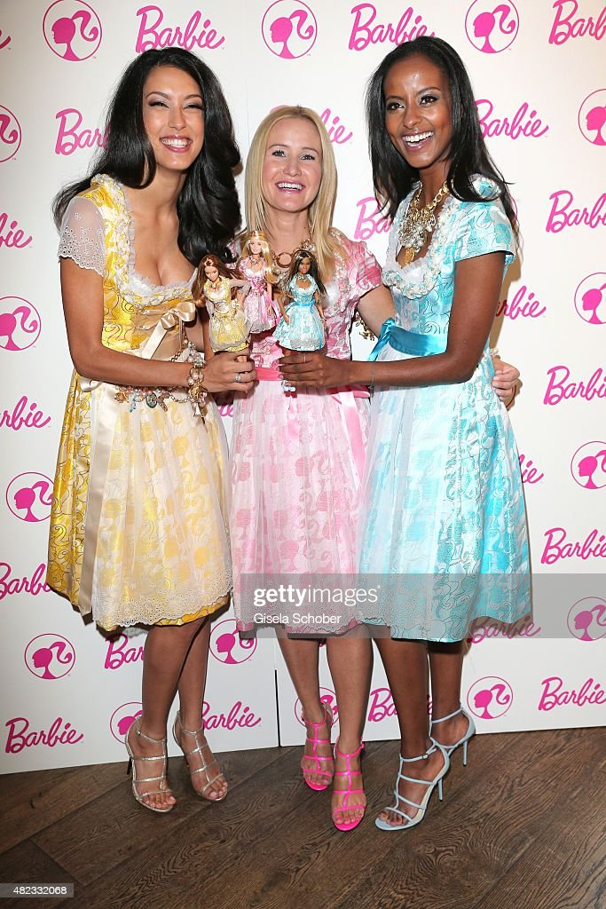 Rebecca Mir, Dirndl Designer Ophelia Blaimer, Sara Nuru wearing a dirndl by Ophelia Blaimer during the Barbie Pre Pink Wiesn Brunch at Kaefer Stuben on July 30, 2015 in Munich, Germany.