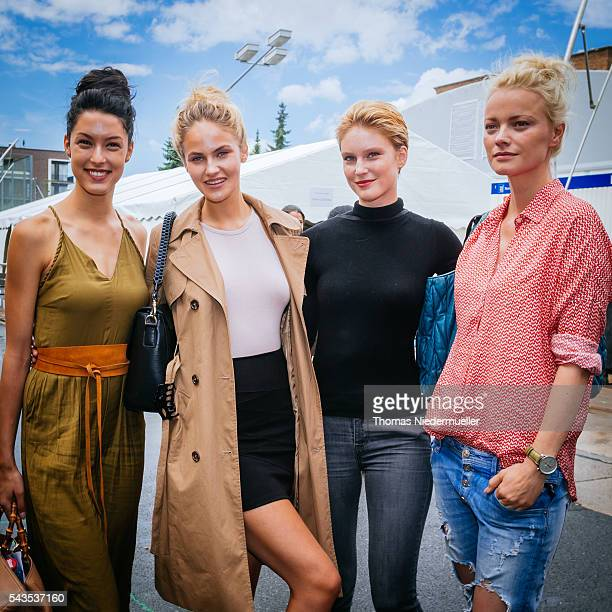 Rebecca Mir Elena Carriere Kim Hnizdo and Franziska Knuppe pose for photographs backstage ahead the Anja Gockel show during the MercedesBenz Fashion...